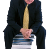 man professional sitting on books
